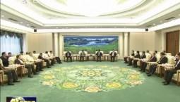 巴音朝鲁景俊海会见出席第七届车载信息服务产业应用联盟大会特邀代表