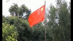 新闻早报|农家小院里的升旗仪式
