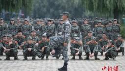 兩部門:高校軍事課實行學分制管理,成績記入學籍